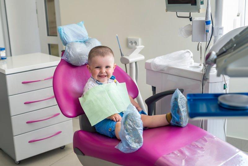 Little boy sitting in a dental chair